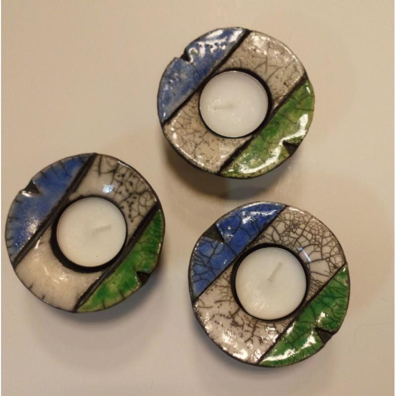 Ljuslykta i rakubränd keramik i de jämtländska färgerna